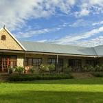 Olive Hill Country Lodge besigtig uit die tuin
